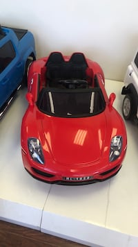 red and black ride-on toy car Toronto, M1V 3Z7