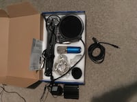 blue microphone with black pop filter