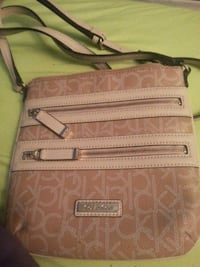 brown and beige Coach leather crossbody bag