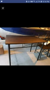 rectangular brown wooden table with black metal ba 533 km