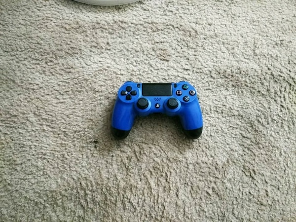 blue and black Sony PS4 controller