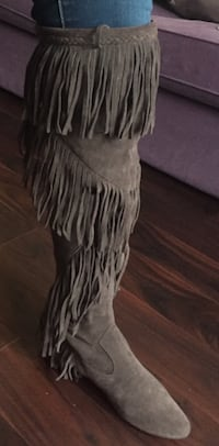 Designer shoes. Pair of knee high fringe brown suede boots Toronto, M2M 3T3
