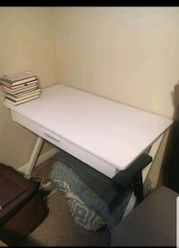 a quality desk with two chairs