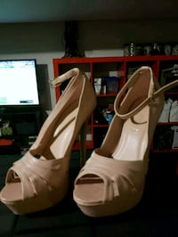 pair of white open-toe ankle strap heels 551 km