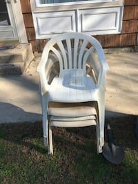 two white wooden armchairs with gray pads 515 mi