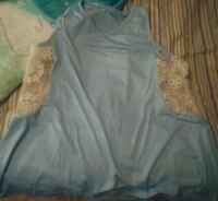 Light blue tank top with lace on sides Las Vegas, 89141