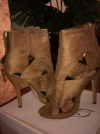 new in box size 8 suedelike platforms.  never worn paid 50 firm
