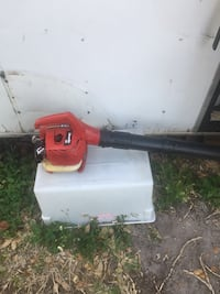 red and black gas leaf blower