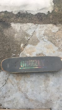 black and green Grizzly skateboard Vernon, V1B 2N3