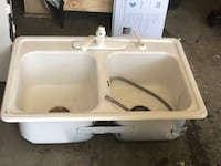 White ceramic sink with faucet Gainesville
