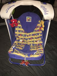 purple and yellow floral bouncer seat