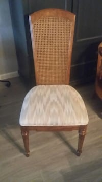 4 brown wooden framed white padded chair