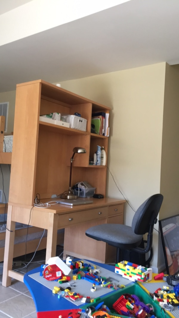 Brown wooden desk with hutch and chair
