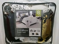 Brand new 8 piece king Paris bed set