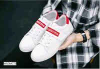 pair of white Adidas low top sneakers Banian, 143116