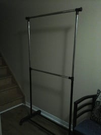 gray and black clothes rack