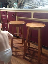 two brown wooden bar stools null