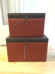 two brown and black leather boxes