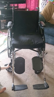 black and gray steel frame wheelchair
