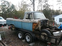 wrecked blue pickup truck McLeansville, 27301
