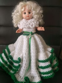 Vintage plastic doll, with hand made dress