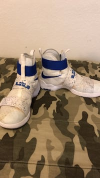 pair of white-and-blue Nike basketball shoes