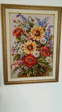 brown, red, and blue petaled flowers cross-stitch artwork Montreal, H3R 3L4