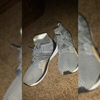 pair of gray Nike running shoes Concord