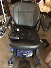 black and blue motorized wheelchair 43 km