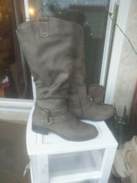 pair of knee high gray leather boots. Size 8 Edmonton, T5H 2Z8