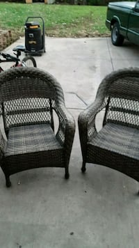 two black wicker armchairs with ottoman 387 mi