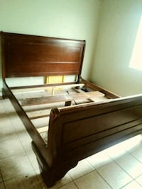 brown wooden bed frame with white mattress Bakersfield, 93306