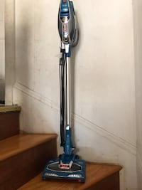 black and blue upright vacuum cleaner Newton, 02464