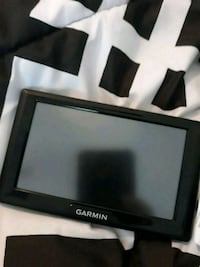 It's a brand new garmin' GPS with charger  Jacksonville, 28546