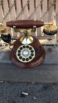 brown and gold-colored rotary telephone