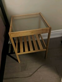 brown wooden framed glass top side table Toronto, M3C 3K6
