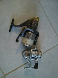 two gray and black spinning reels