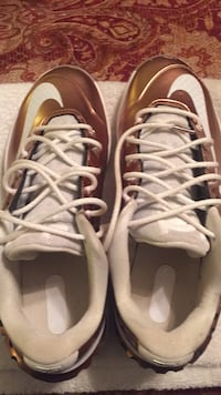 Pair of brown-and-white nike shoes Gastonia, 28052