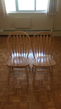 two brown wooden windsor chairs