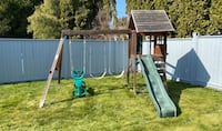 Swing set with slide and treehouse