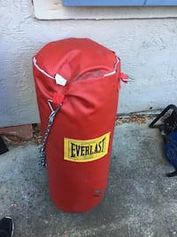 red and yellow Everlast heavy bag