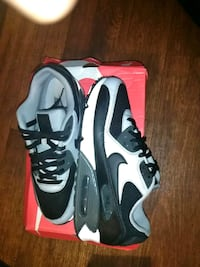 pair of black-and-white Nike basketball shoes 2052 mi