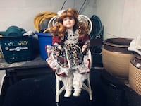 Electric Porcelane doll in chair  arms and head moves