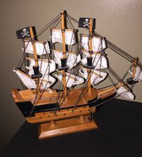 "Model Wooden Pirate Ship, made by agiftcorp 6""Hx 6 1/2"" L  This is a nice Model Wooden Pirate Ship, made by agiftcorp It is approx.6""Hx 6 1/2"" L and in very good condition made with wood and cloth"