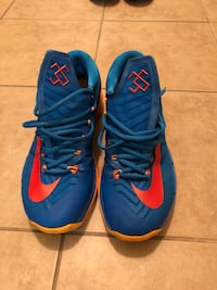 pair of blue-and-orange Nike basketball shoes Tallahassee, 32308