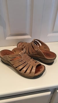Pair of tan leather slip on sandals