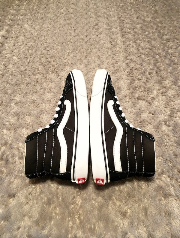 Vans hi-top paid $80 size 7 good condition women's size 8.5 . Black with white stitching. 8659f72d-7960-4824-9c14-99335e4511a7