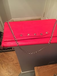 Betsey Johnson red clutch bag with removable chain strap. New without Tags, never been used. Very cool lining. Cochrane, T4C 1K6