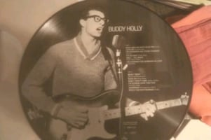 Buddy holly collectors item record.  Photo on record - heavy record.