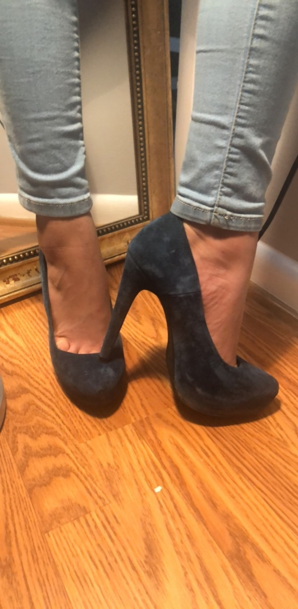 pair of black suede booties